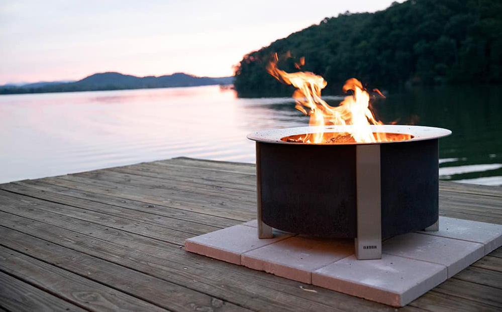 Fire pit on wooden deck next to water